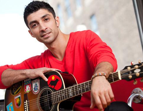 Noah Aronson with guitar